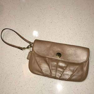 Iridescent nude pink Coach clutch